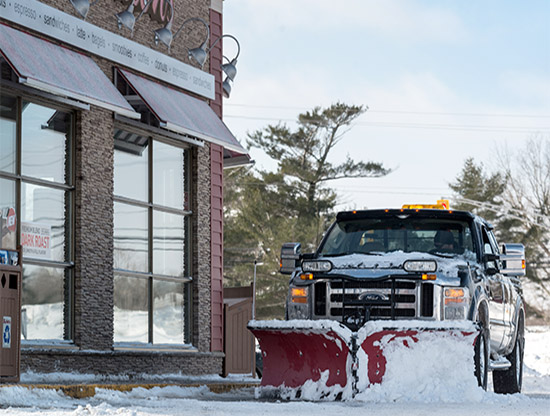 Commercial snow plowing by YPMG Maintenance